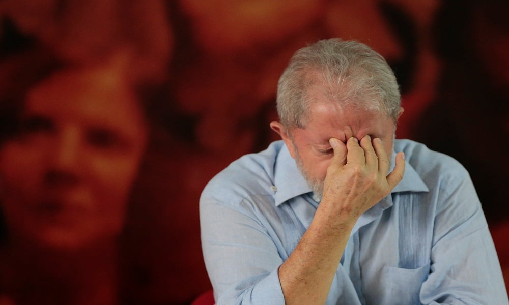 Former Brazilian president Luiz Inacio Lula da Silva reacts during a meeting with members of the Workers Party (PT), that decided Lula da Silva will be its candidate again in the 2018 election, despite losing an appeal against a corruption conviction that will likely bar him, in Sao Paulo, Brazil, January 25, 2018. REUTERS/Leonardo Benassatto NO RESALES. NO ARCHIVES